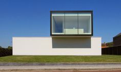 Steven De Jaeghere Architectuuratelier designed House VRT, a minimalistic family house in Tielt, Belgium consisting of a composition of tw...