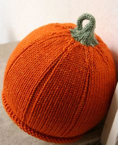 Pumpkin shaped baby hat with rolled brim and i-cord stem.