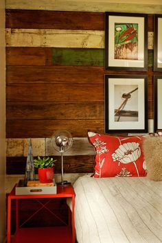 Reclaimed with color. This fun, rustic wood accent wall features reclaimed wood with a touch of color. The punchy red accent table looks rig...