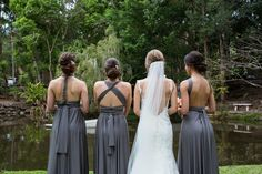 Grey bridesmaid dresses tied differently