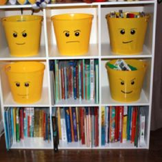 Great storage idea for your LEGO fanatic.... Take yellow bins from the dollar store and draw LEGO faces with a black Sharpie. Put a drop of white paint in the black of the eyes for a more authentic look.