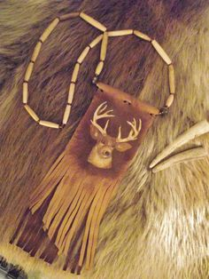 My newest venture and creation! Hand Painted Whitetail Deer on Leather Fringed by BlackBearsBazaar, $79.99