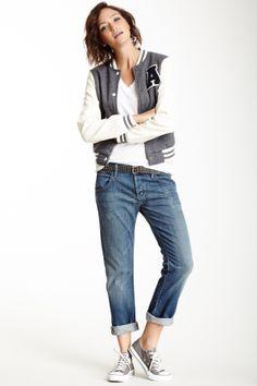 Boyfriend Jeans, white T-shirt, varsity jacket, grey Converse.