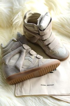 Isabel Marant wedge sneakers, adding heel height, suede material but comes in leather, casual vibe