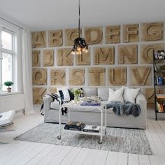 One of our alphabetical typography wall murals. This wallpaper pictures the alphabet carved in wood.