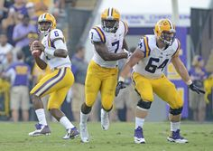 Advocate staff photo by BILL FEIG -- From left, LSU quarterback Brandon Harris, running back Leonard Fournette and center William Clapp got precious few snaps Saturday against McNeese State before lightning nixed the season opener at Tiger Stadium.
