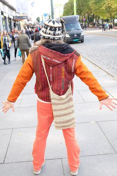 A man in many colours photographed on the main street of Oslo. He did not want to show his face