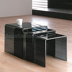 A classic modern and contemporary smoked glass nest of 3 tables which fit neatly inside each other. As well as looking a fantastic piece of glass furniture on its own, the space saving tables can be p...
