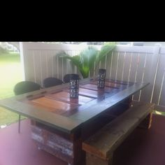 Outdoor table made out of a 100 year old door.  Kept hardware ...