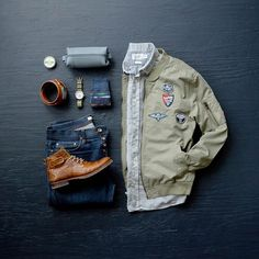 Patch bomber jacket from Flag And Anthem Co., Shirt from Grayers, Boots from Bullboxer, Belt from Anson Belt, Watch from Vaer Adventure and Cologne from Bawston and Tucker #mensfashion #mensstyle #fashiongrid #grid