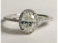 Oval Halo Diamond 1ct $2500. But not keen on diamonds going all the way around band