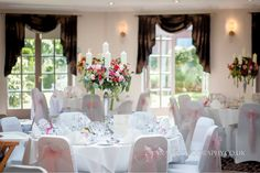A wedding at Rossett Hall Hotel which we dressed using white chair covers and a soft dusky pink coloured organza sash.  Table centres by Vivid Floral Design.  Photo by Yana Photography