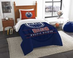 Edmonton Oilers NHL Draft Twin Comforter and Sham Set. Includes 1 Sham and 1 Twin Comforter. Visit SportsFansPlus.com for Details.