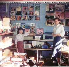 Betsy Walker and Carol Pearson in the record department of Pearsons' Hardware Store in Springville--late 1950's.
