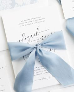 Gorgeous modern calligraphy wedding invitations with a dusty blue floral envelope liner and a custom dyed 100% silk ribbon in french blue. We can't get enough of our Romantic Calligraphy Wedding Invitations. Click here to customize your perfect suite!
