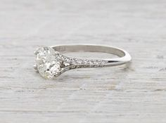 Knife Edge engagement ring handmade in platinum featuring an antique old European cut diamond.