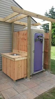 We purchased a (clean) used porta potty and put a fresh spin to it, added a cedar sink and it turned out beautifully. No more tracking into our home when we have large gatherings. Outside Toilet, Outdoor Toilet, Outdoor Baths, Outdoor Bathrooms, Outdoor Showers, Outdoor Spaces, Outdoor Living, Outdoor Decor, Garden Structures