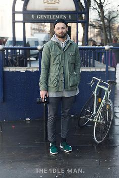 London Collections Men street style, army green jacket, a grey hoodie, relaxed jeans and fresh kicks | The Idle Man