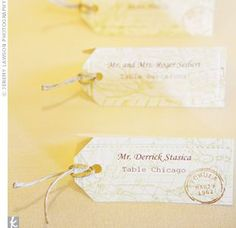 Luggage tags with an antique map design guided guests to their tables and fit in with the travel theme.