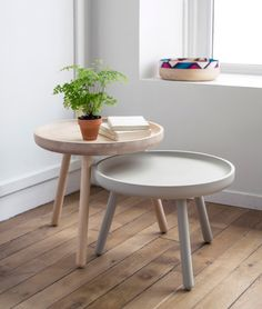 Bob Tables are coffee tables with solid turned wood tabletops that sit on three little feet, reminiscent of old shepherd stools