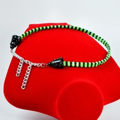 Make a structural statement with this green-and-black Czech glass choker. It features two strands of round Czech glass beads connected by green two-hole glass for an architectural look. On each side, strands are joined by a silver-flecked black glass bead cone and a black Swarovski crystal pearl connected to a sliver chain and matching lobster clasp. Length is adjustable from 14 to 16 inches. A striking, one-of-a-kind gift, or a versatile addition to your own wardrobe. Perfect for day or…