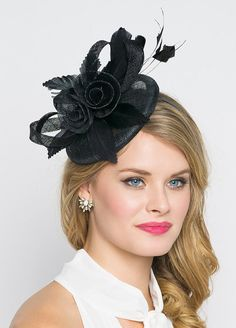 Emelia Rose Black Fascinator This vintage-inspired fascinator is as timeless as a fairytale. Let your personality add life to its floral center and ribbon loop accents. Its round base and slip-on headband will allow you to look flawless and enjoy any event with ease! - Easy wear headband - Round sinamay base