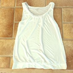 LOFT Medium White Bottom Banded Tank Top LOFT Medium White Bottom Banded Tank Top. Very lightweight, perfect for hot days of summer or with a light cardigan in spring. EUC. Band on Bottom. A must have for any wardrobe! LOFT Tops Tank Tops