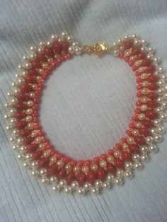Pearl Choker Necklace Tutorial  This Pearl Choker is a classic jewelry piece.A choker is usually made up of 3 or more strands and it lays beautifully on neck.I have also used Maroon Stone beed and Kundan Stone with 2 holes to enhance the beauty of the choker.