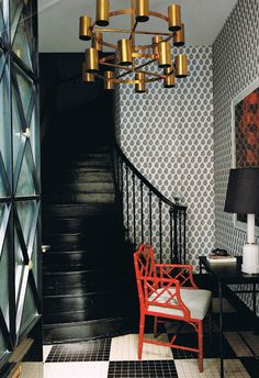 Amazing entry in black and white. The mix of patterns on the floors and walls, and the glossy black staircase look so good together. A red chair and gold chandelier adds some color and contrast to the space. Black Staircase, Staircase Design, Foyer Design, Lobby Design, Design Entrée, House Design, Design Trends, Design Ideas, Design Elements