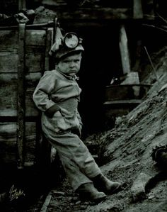 Child Labor at the coal mine. Turn of the century. This little guy is so young, but looks mean as shit!
