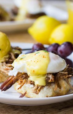 Southern Eggs Benedict _ A classic recipe for Eggs Benedict with a regional (Southern) twist, served on a biscuit instead of an English Muffin with pulled pork taking the place of Canadian bacon.