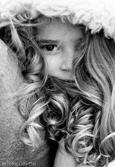 Beautiful pose.  Little girl with curls!