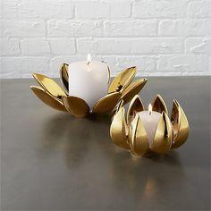 Shop 2-piece dahlia pillar-tea light candle holder set.   Serene stoneware duo reflects zen in mirrored golden glaze.  Bloom nests a single tea light, or separates into two-part harmony to pedestal a single pillar. $24.95