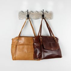 A simple and stylish large tote perfect for work or everyday use. Handcrafted from luxurious thick and supple genuine leather that ages beautifully. The leather has a slight vintage distressed look giving it a vintage vibe and is thick enough that the bag holds its shape and structure. The handles easily fit over the shoulder and the purse also comes with a long adjustable shoulder strap so it can also be worn across the body. The purse closes with a zipper.  The large pocket on the front…
