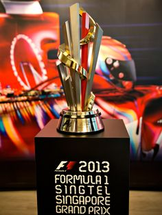 An unofficial guide to the 2013 Formula 1 Singapore Grand Prix.plus a bit of history Lewis Hamilton Formula 1, Singapore Grand Prix, Sports Trophies, Trophy Design, Grid Girls, Formula One, Ferrari Laferrari, Lamborghini Gallardo, Auto Racing