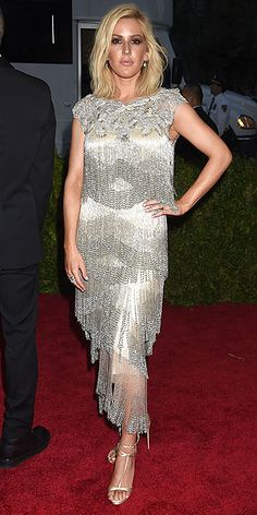 100+ Unforgettable Dresses from the 2015 Met Gala | ELLIE GOULDING | in a flapper-inspired silver, fringed, tiered Marchesa gown, with T-strap metallic sandals and Marchesa Eternal jewelry.