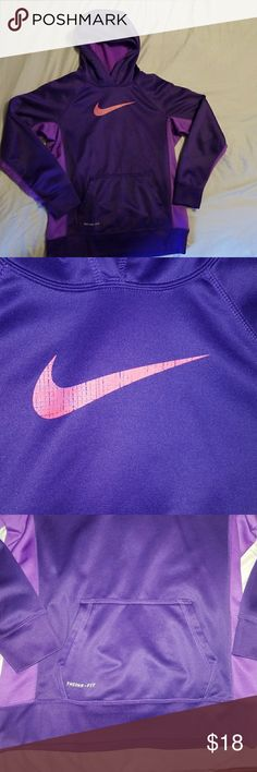 Nike hoodie Girls Nike hoodie  youth size extra large in perfect condition no holes or stains..with pockets in front super cozy..still looks new it is dark purple in color with a light purple down the sides..very cute Nike Jackets & Coats