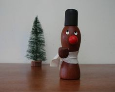 Vintage Danish Modern Teak Figure Candlestick holder with pipe and felt scarf. Design attributed to Danish designer Laurids Lonborg. Adorable with his eyes glancing up to the top of the candle!