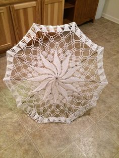 Crochet lace umbrella for steampunk outfit.
