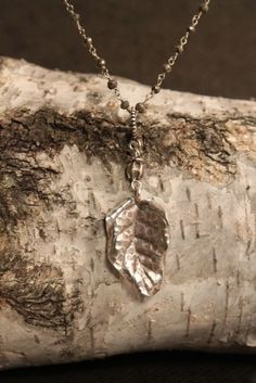 "Jill Duzan — Thai Leaf AP04 Love nature? Then this Thai leaf is for you. 1.25"" long and just the right patina it's a great addition to any chain or JD necklace. Shown on our Mia handtied pyrite."