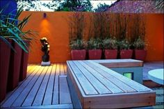 Back-yard modern deck Orange wall for modern garden design
