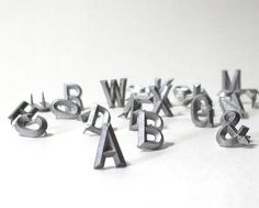 Vintage metal letters, for that literary touch.