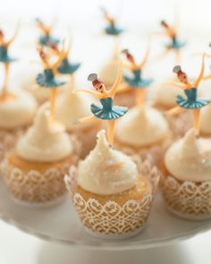 "These nostalgic ballerina toppers remind Darcy of the snowflake ballerinas from George Balanchine's ""The Nutcracker."" Vanilla Cupcakes, One Girl Cookies Cake Liner, Fancy Flours Ballerina Toppers, NY CakeCakestand, Macy's (similar)"