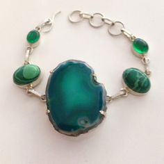 💯% 925 Sterling Silver Druzy peridot bracelet💚 💯%925 Sterling silver chain link bracelet with bezel green 💯%malachite & peridot green gem stone 💚embellishments, with natural Aqua/Green Druzy gem stone centerpiece that measures 1.5 X 1.4 inches in L X W. Toggle closure, Length adjusts from 6.5-8 inches. Handmade/crafted Beauty💞. Very unique, new without tags. Gorgeous one of a kind bracelet!!! 💚💚💚💚 Handmade Jewelry Bracelets