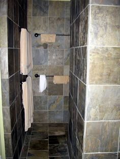 walk in showers without doors   nice. It has a walk-in shower with no door. There are three shower ...