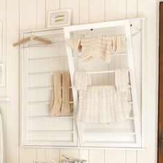 Beadboard Drying Rack from Ballard Designs.  Keeps clothes out of the way of pets and children.