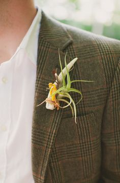 antler boutonniere // photo by Colagrossi Studio, flowers by Orchid and Willow, view more: http://ruffledblog.com/riverside-bohemian-wedding-shoot/