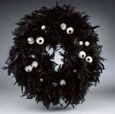 halloween wreath! (takes 2 feather boas, 10 styrofoam balls, some wiggly eyes) Change to lime green boa with orange and purple mesh ribbon and halloween things other than eyes.