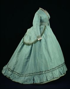 Dress  Place of origin:Great Britain (made)Date:1868 (made)Artist/Maker:Unknown (production)Materials and Techniques:Silk trimmed with braid, satin, linen, beads, brass, bobbin lace and silk fringe, lined with cotton and boned