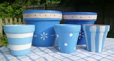 Blue painted flower pots with ribbon, to use for wedding table centre-pieces